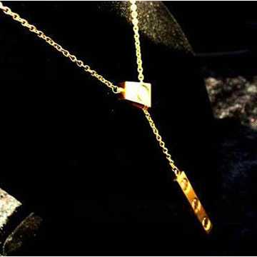 Cartier love Y shape necklace 18 carat yellow gold
