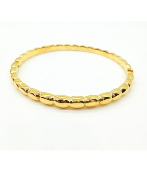 Van Cleef & Arpels Perlee Bangle Bracelet in Yellow Gold